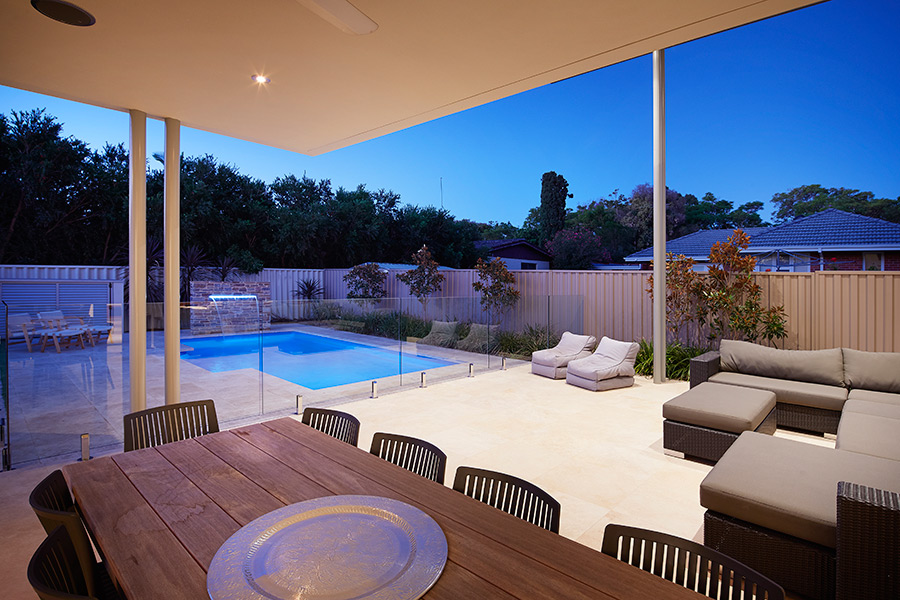 A great backyard is complete with a swimming pool and water feature