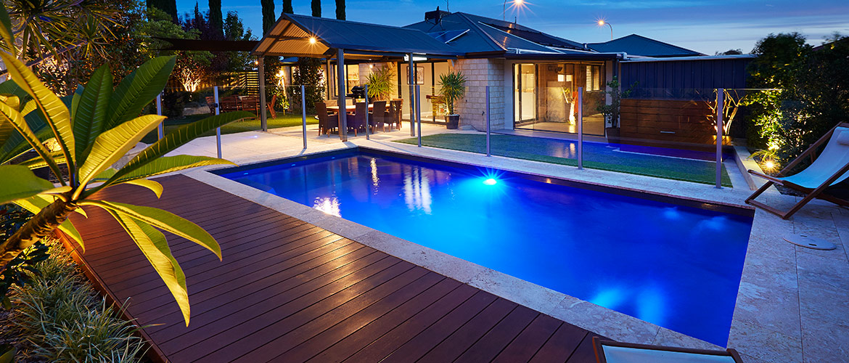 """Provincial"" medium inground fibreglass swimming pool design, pictured in backyard"