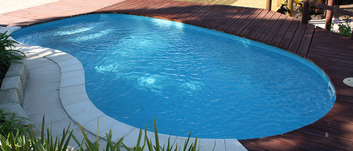 """Maxi-Swim"" small kidney-shaped inground fibreglass swimming pool"