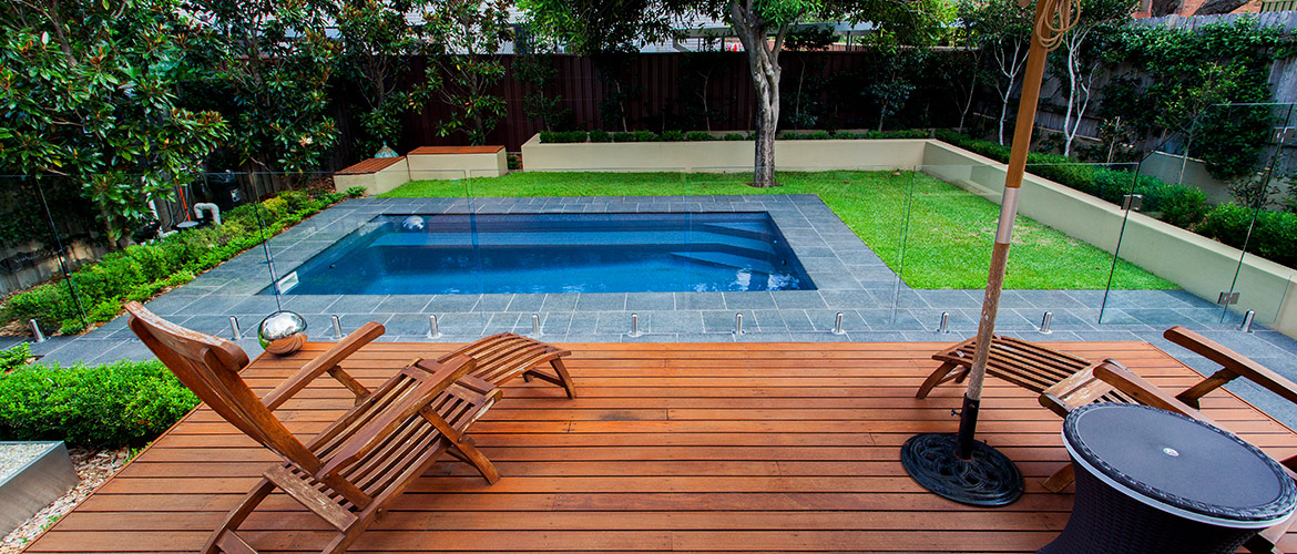 """Sovereign"" small inground fibreglass swimming pool design, pictured in backyard"