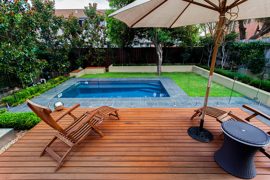A swimming pool is perfect compliment to a wooden deck in your backyard