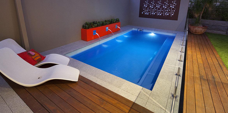 """Empire"" small inground fibreglass swimming pool design, pictured in backyard"