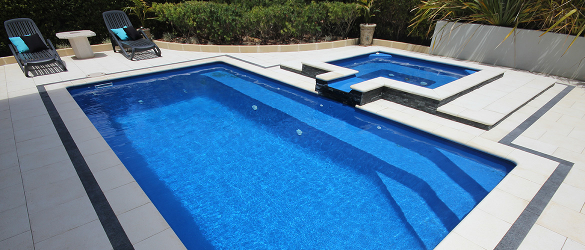 """Empire"" small inground fibreglass swimming pool design, pictured as backyard pool, with pool spa (Spillway Spa)"