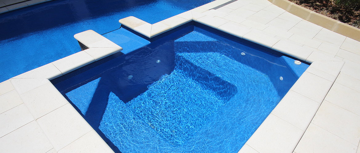 """Vail"" Fibreglass Pool Spa Design, pictured as backyard pool spa, in ""Assana Blue"" pool colour"