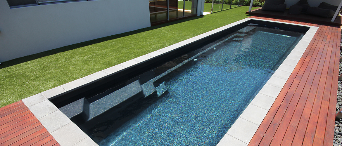 """Duchess"" Large Fibreglass Pool Design in Perth, pictured as backyard pool, in ""midnight storm"" pool colour"