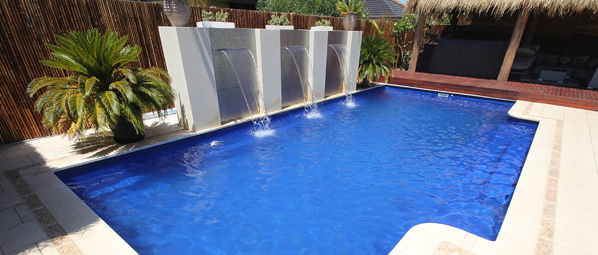 """""""Regal"""" Fibreglass Pool Design in Perth, pictured as backyard pool, with """"Moonlight Blue"""" pool colour"""